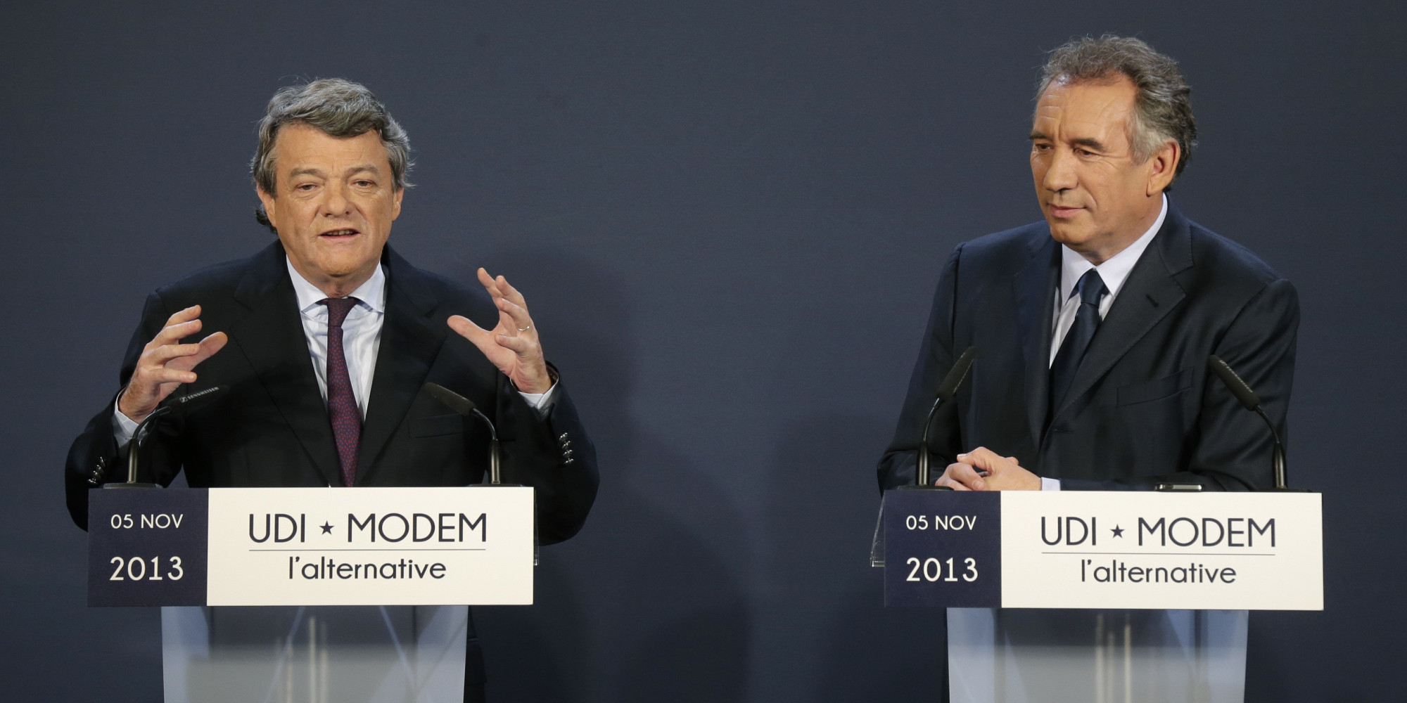 Head of the UDI party Borloo and MoDem party leader Bayrou attend a news conference to announce the union of their centrist parties ahead of 2014 municipal and Europea Parliament elections in Paris